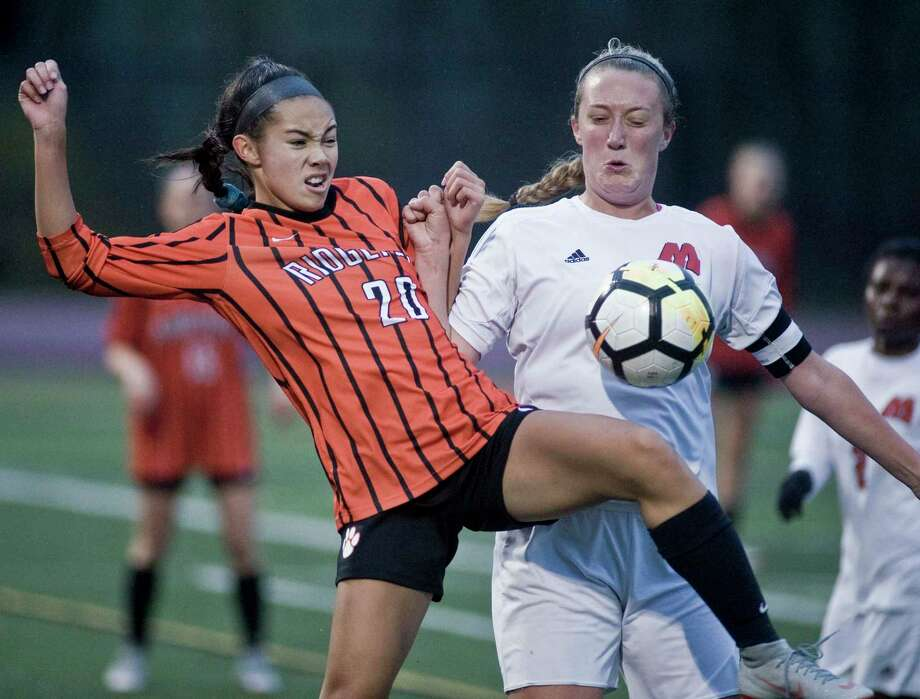 Ridgefield High School's Julia Bragg and Manchester High School's Samantha Jones collide in the Class LL girls soccer game at Ridgefield. Monday, Nov. 5, 2018 Photo: Scott Mullin / For Hearst Connecticut Media / The News-Times Freelance