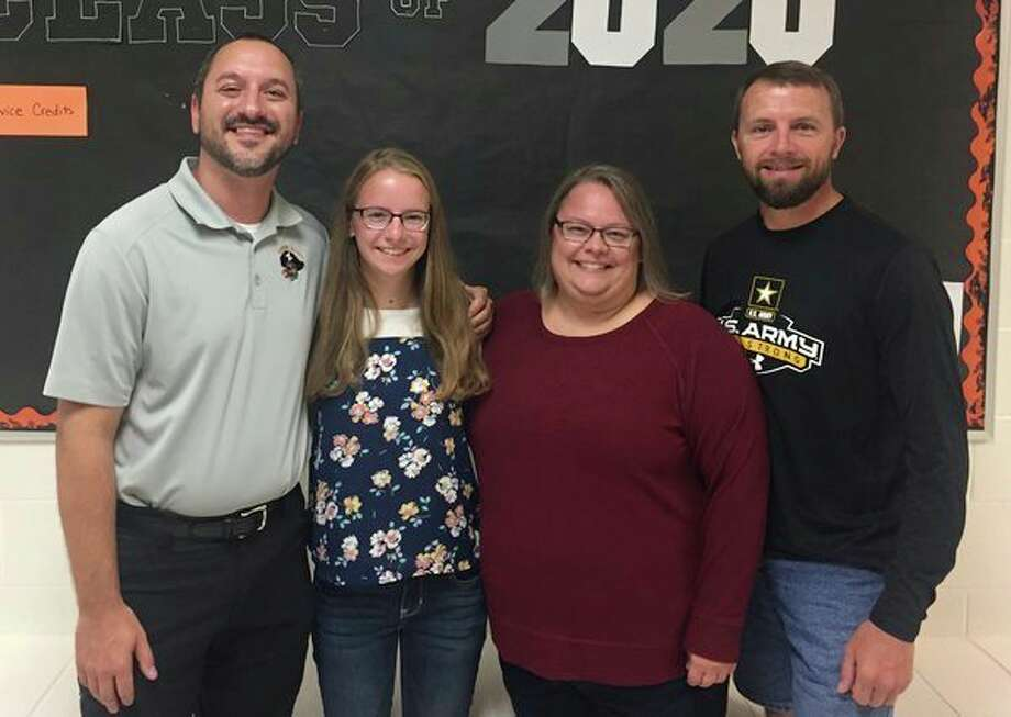 Harbor Beach middle and high school principal, Aaron Bulgrien, is pictured with Hanna Emerick and her parents, Jennifer and Bill Emerick. Hanna recently was named a national merit semifinalist. (Submitted Photo)