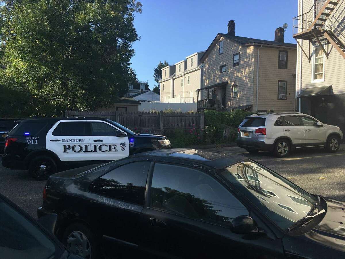"""Police arrested four people at this two-story house on Balmforth Avenue Thursday afternoon. One man was charged with assaulting a police officer and was tasered after authorities say he began """"punching and kicking"""" as officers tried to take him into custody."""