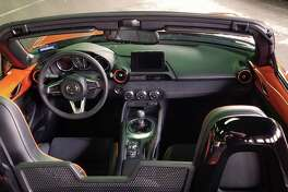 The commemorative Miata is unique, thanks to the racing orange theme carried over into the cabin.