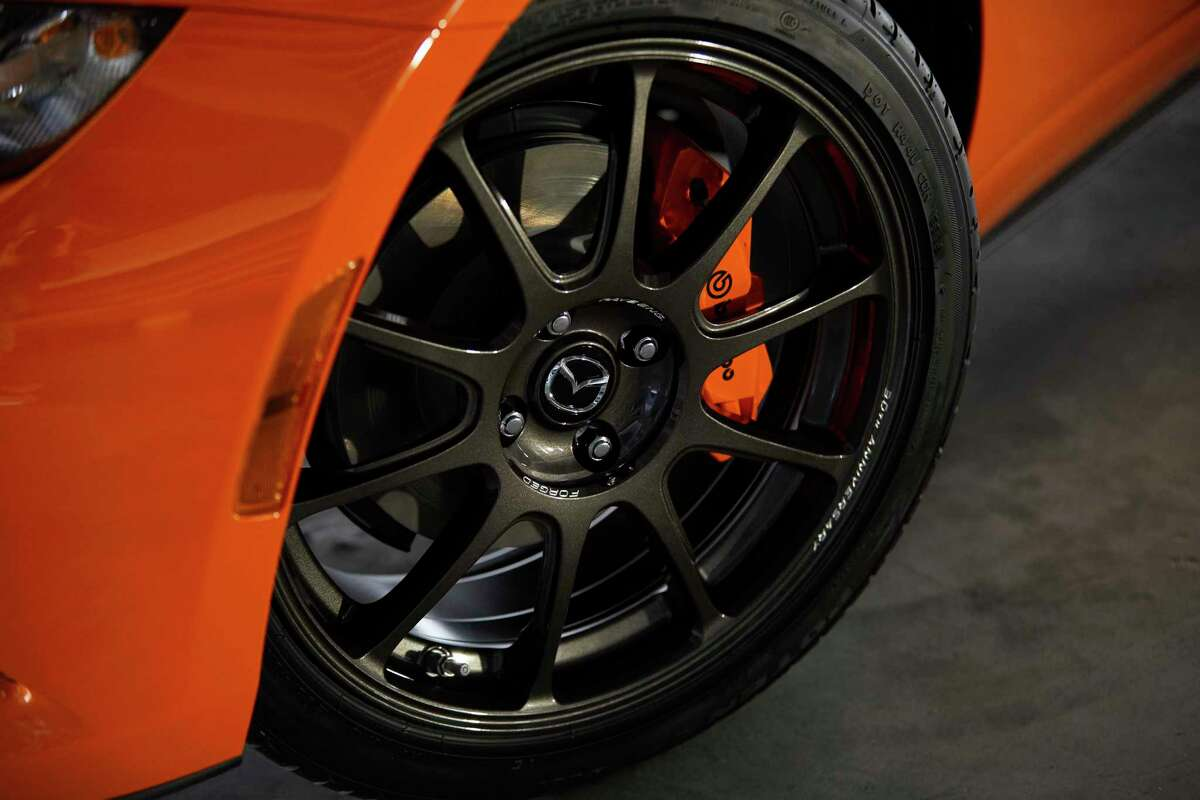 Brembo front brakes, 11-inch vented discs, orange calipers and exclusive Rays forged wheels are standard fare.