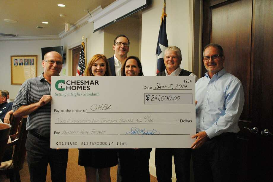 From left are: Scott Merovitch, city president/Houston for Chesmar; Casey Morgan, CEO of the GHBA; John Williams, president of GHBA, Carole Brady, executive director of HomeAid, Lee Kirgan, VP project management for Operation Finally Home'; and David Assid, Toll Brothers Houston division president.