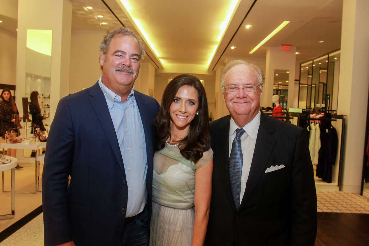 Cal and Hannah McNair, from left, with her father, Charlie Hartland at the Women of Distinction announcement at Tootsies on September 18, 2019.