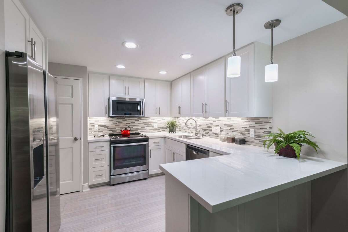 Kitchens feature ceramic tile floors, stainless-steel appliances and granite countertops.