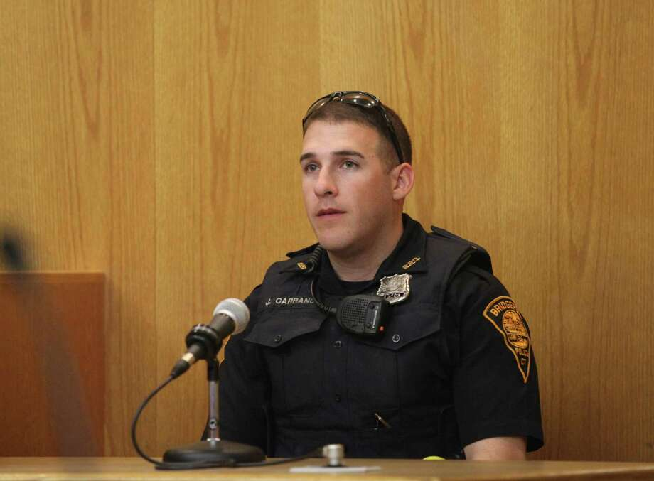 "Bridgeport police officer John Carrano testifies at trial for Tyree Smith before a three judge panel in Bridgeport, Conn. on Monday, July 1, 2013. Smith is charged with the murder of Angel ""Tun Tun"" Gonzalez. Photo: BK Angeletti / B.K. Angeletti / Connecticut Post freelance B.K. Angeletti"