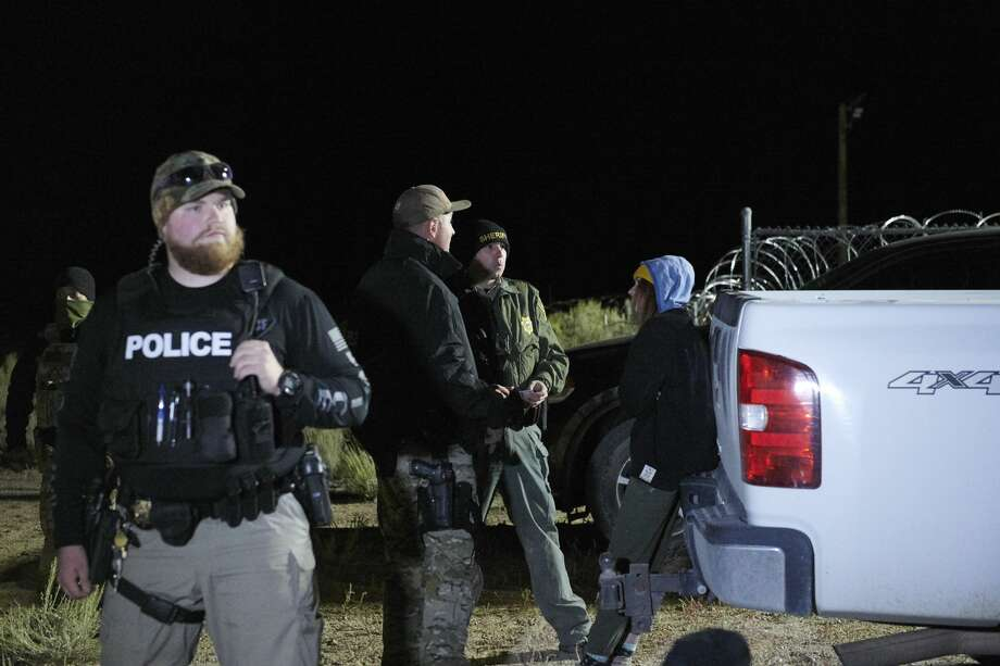 "An attendee is detained then released after briefly physically crossing a security line , as attendees gathered to ""storm"" Area 51, at an entrance to the military facility near Rachel, Nevada on September 20, 2019. Photo: BRIDGET BENNETT/AFP/Getty Images"