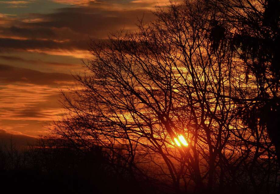 Brilliant reds mark this summer sunset in Connecticut this year. Photo: Contributed Photo /John Pirro
