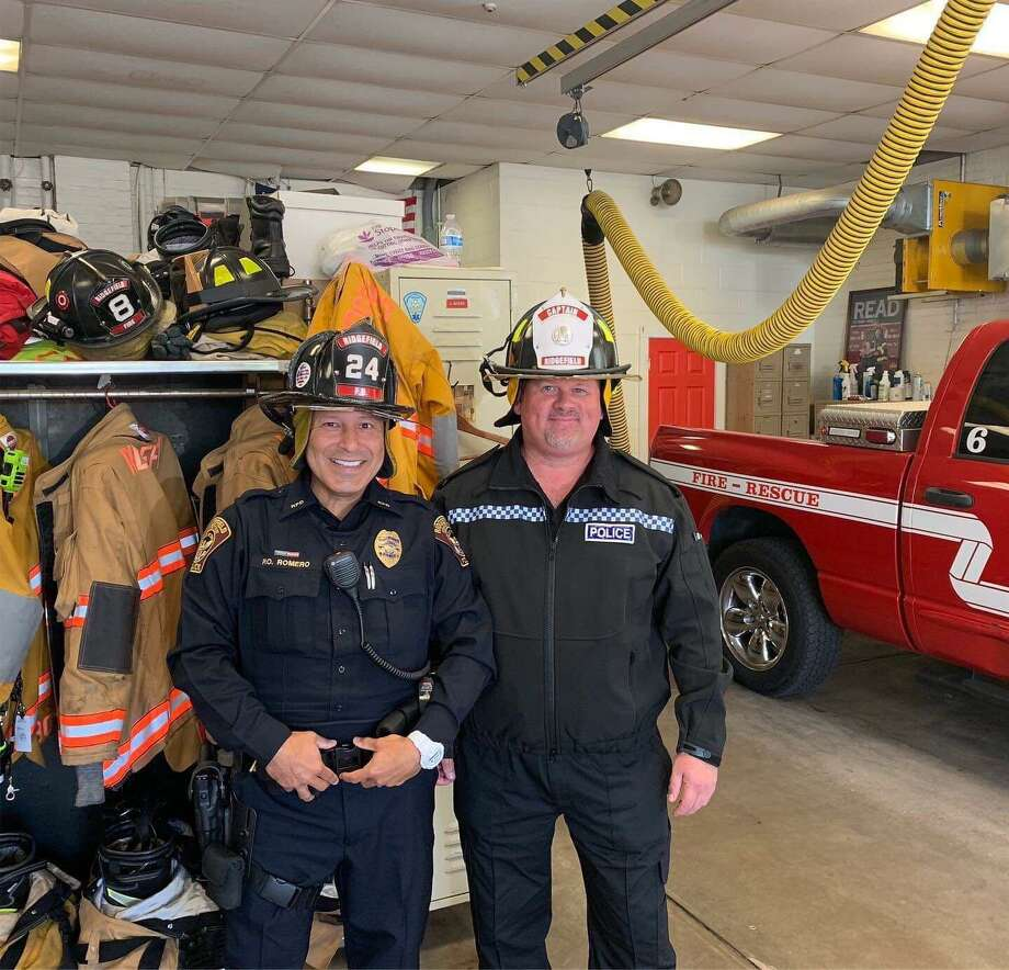 PC Steve Hutton and Ridgefield officer Jorge Romero visit the Ridgefield Fire Department. Photo: Contributed Photo