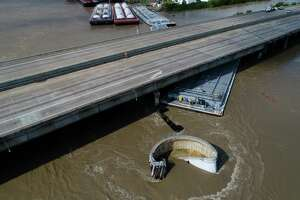 Interstate 10 at the San Jacinto River was shut down after at least two barges struck the bridge Sept. 20, as the remnants of Tropical Storm Imeldo drenched Houston and East Texas.