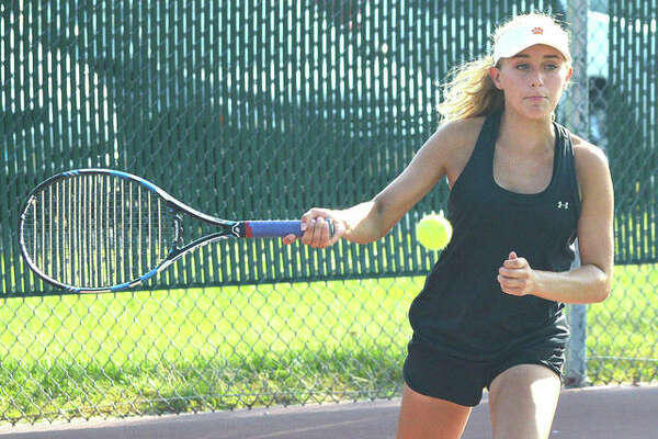 Edwardsville junior Grace Hackett makes a forehand return during her No. 2 doubles match against Belleville East on Thursday at the EHS Tennis Center.