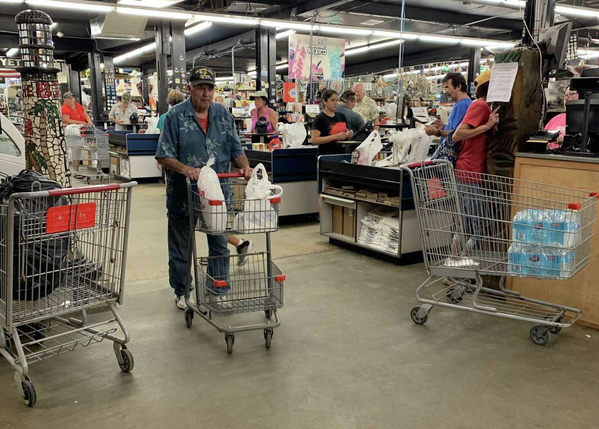 Customers flocked to Gulf Coast Supermarket Friday morning in Crystal Beach, one of the only businesses open thanks to a backup generator, after Tropical Storm Imelda knocked out power on Bolivar Peninsula.