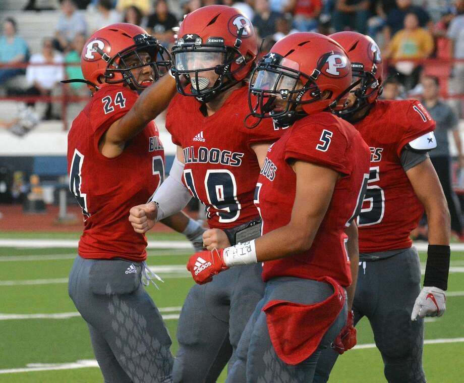 Plainview players Ethan Campos (24), Brant Rollins (19) and Jaidyn Luera and the rest of the Bulldogs have a tough task when it comes to taking on the Dumas Demons, who are ranked No. 8 in Class 4A Division II. Photo: Nathan Giese/Planview Herald