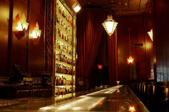 cliftlighting101.jpg The Redwood Room at San Francisco's Clift Hotel is known for its' mood lighting complete with lights inset into the bar and a large liquor display case. {Brant Ward/The Chronicle} 10/24/06