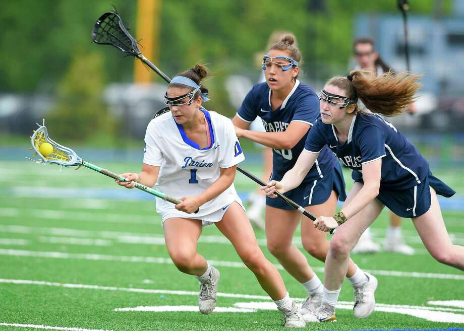 Staples' Kyle Kirby (24) and Christine Taylor (20) defend the drive of Darien's Nicole Humphrey (1) in a FCIAC girls lacrosse quarterfinal game at Darien High School in Darien, Conn. on May 16, 2017. Darien defeated Staples 18-6. Photo: Matthew Brown / Hearst Connecticut Media / Stamford Advocate