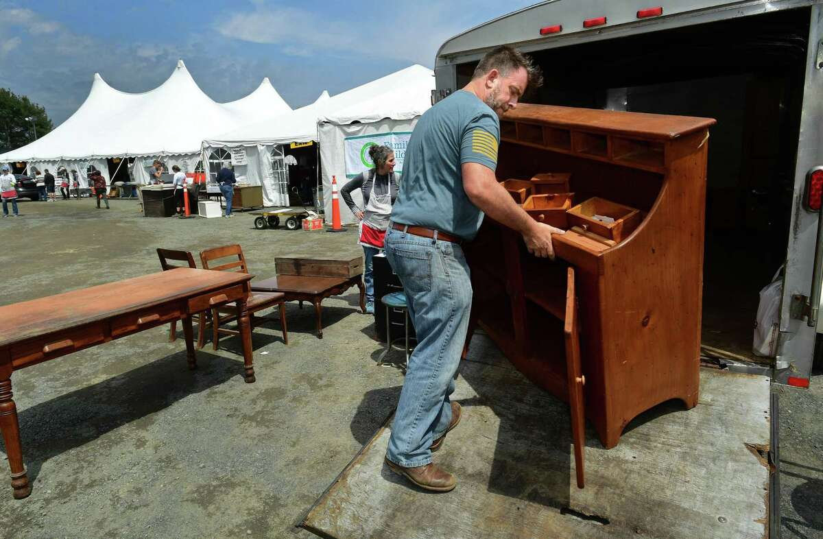 Tim Smith of Redding unloads furniture at this spring's Minks to Sinks donation and consignment drop-off. Donations and consignments for the fall sale benefiting the Family and Children's Agency in Norwalk may be dropped off Oct. 1-3.