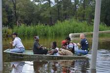 Pinehurst water rescues in Camalot area Friday performed by Pinehurst Fire Department. Photos provided by Eric Williams