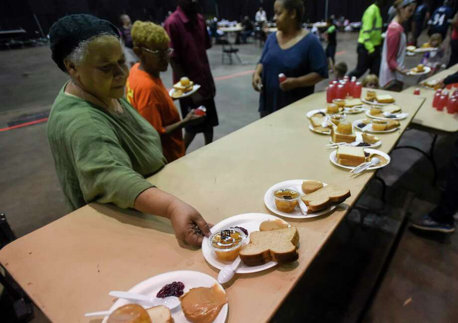 A women grabs lunch at the Beaumont Civic Center after the center was turned into an emergency shelter for those effected by flooding Friday. The shelter was working to move people to the emergency shelter at Central High School in Beaumont Friday. Photo taken on Friday, 09/20/19. Ryan Welch/The Enterprise Photo: Ryan Welch, Beaumont Enterprise / The Enterprise / © 2019 Beaumont Enterprise
