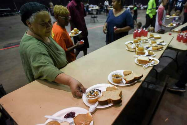 A women grabs lunch at the Beaumont Civic Center after the center was turned into an emergency shelter for those effected by flooding Friday. The shelter was working to move people to the emergency shelter at Central High School in Beaumont Friday. Photo taken on Friday, 09/20/19. Ryan Welch/The Enterprise