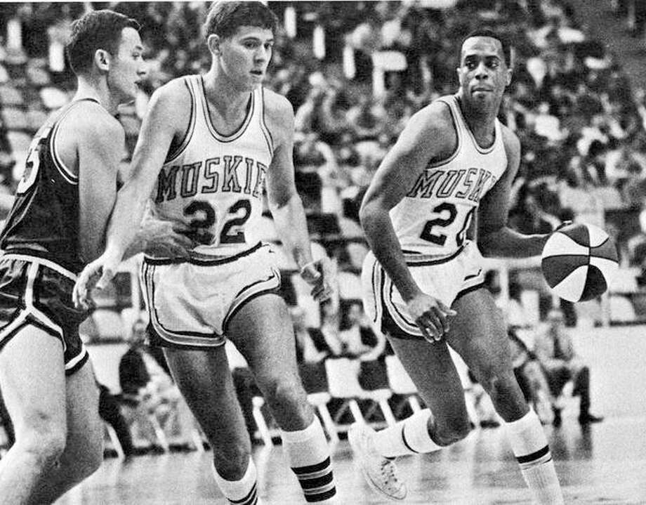 Don Freeman, a former standout for the Fighting Illini and a graduate of Madison High school, right, was elected to the Illinois Hall of Fame this season. Following Friday's scheduled UI Hall of Fame ceremony, Freeman will travel to Madison, where the school's gym will be named in his honor. He is shown in action during his playing days with the Minnesota Muskies of the American Basketball Association. Photo: File Photo