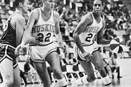 Don Freeman, a former standout for the Fighting Illini and a graduate of Madison High school, right, was elected to the Illinois Hall of Fame this season. Following Friday's scheduled UI Hall of Fame ceremony, Freeman will travel to Madison, where the school's gym will be named in his honor. He is shown in action during his playing days with the Minnesota Muskies of the American Basketball Association.