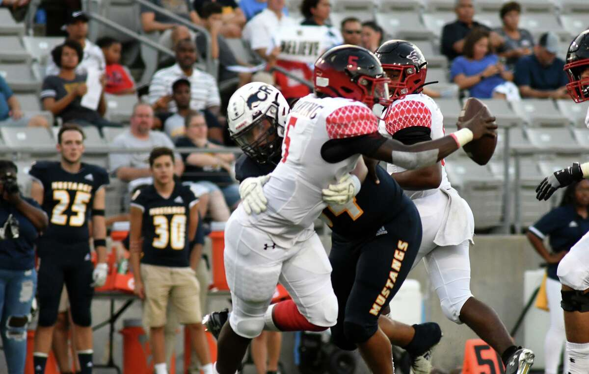 Cy Ranch junior defensive lineman Blane Channel , center, works to sack Langham Creek senior quarterback Kelon Manning in the first quarter of their matchup at Cy-Fair FCU Stadium in Cypress on Sept. 12, 2019.