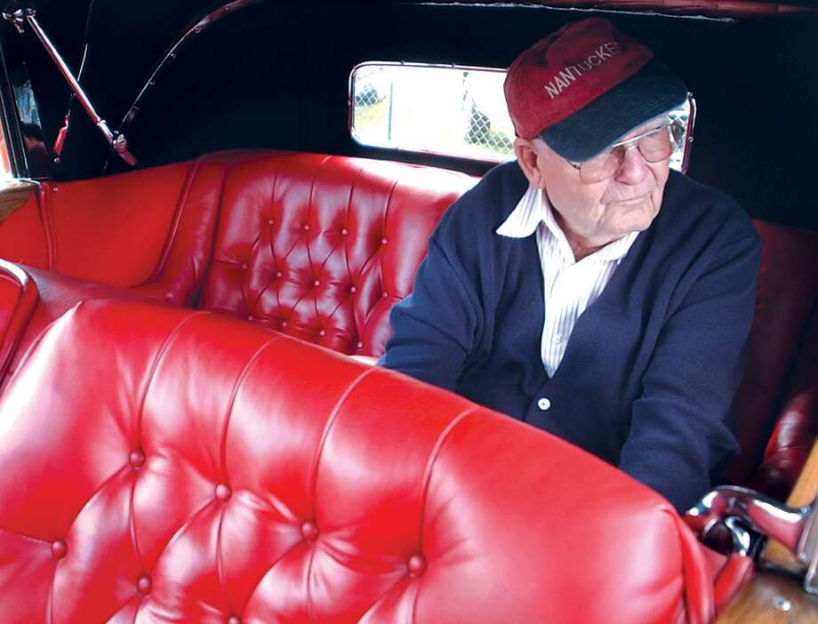 Jarvis Barton of Cobalt relaxes inside his 1932 Chrysler Imperial, one of only 15 left in existence, at Pat Kidney Field in Middletown during the 18th Annual Middlesex County Historical Society Antique and Classic Car Show in 2003. Photo: Hearst Connecticut Media File Photo