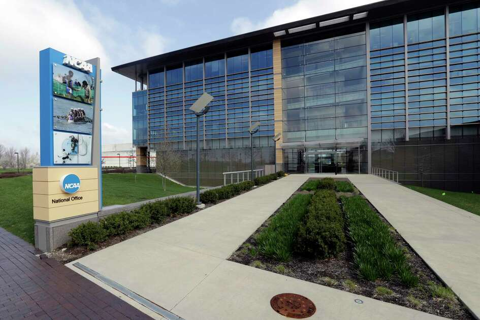 FILE - This is an April 25, 2018, file photo showing NCAA headquarters in Indianapolis. The NCAA's Board of Governors is urging Gov. Gavin Newsom not to sign a California bill that would allow college athletes to receive money for their names, likenesses or images. In a six-paragraph letter to Newsom, the board said the bill would give California schools an unfair recruiting advantage. As a result, the letter says, the NCAA would declare those schools ineligible for its events. (AP Photo/Darron Cummings, File)
