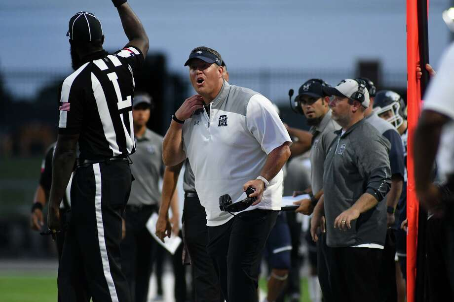 Tomball Memorial Head Coach Sam Parker, center, argues a no-call against one of his players in the 2nd quarter of their matchup with Cy Woods at Pridgeon Stadium in Cypress on Friday, Sept. 13, 2019. Photo: Jerry Baker, Houston Chronicle / Contributor / Houston Chronicle