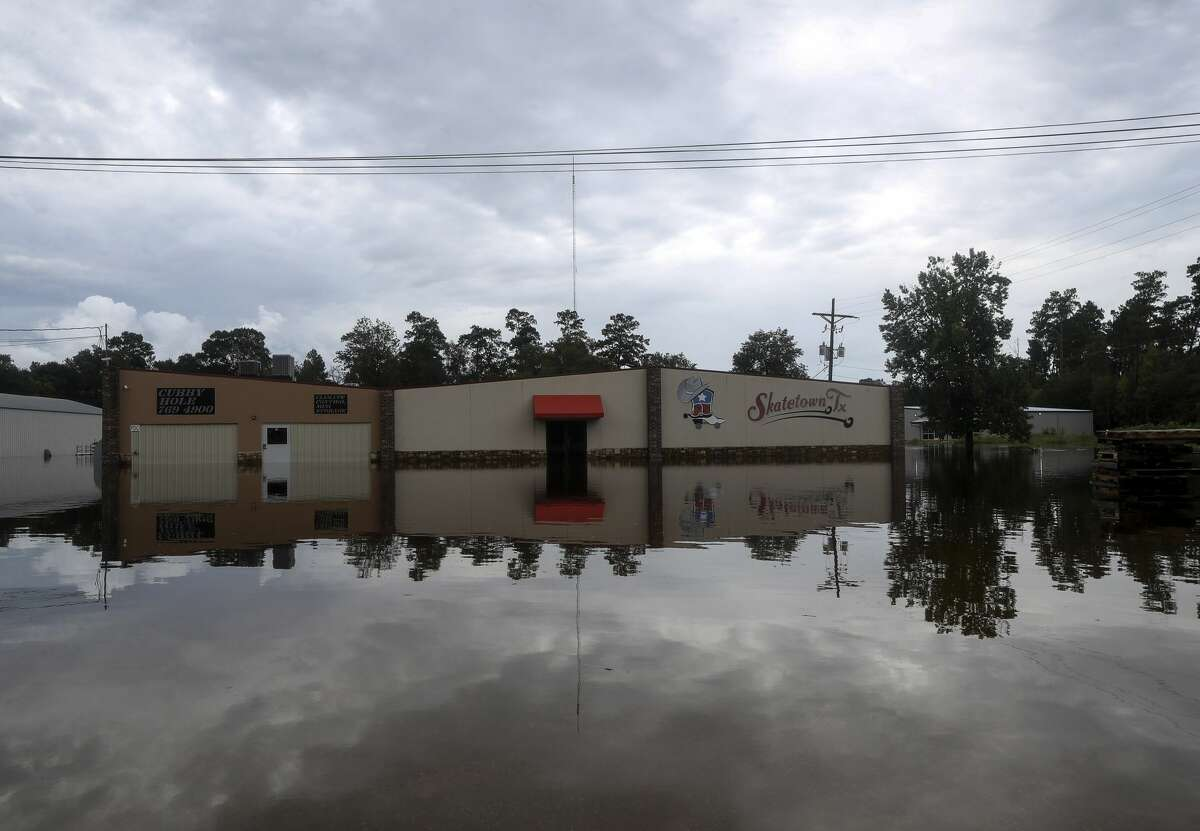Flooding from the remnants of Tropical Depression Imelda continues in Southeast Texas on Friday, Sept. 20, 2019, in Vidor.