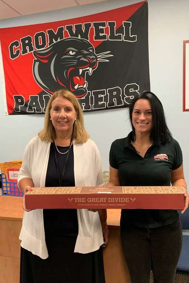 In August, D'Angelo Grilled Sandwiches undertook a massive effort, giving away nearly 300 feet of sandwiches to teachers all across New England as they prepared for the start of the school year. Above, a D'Angelo staff member delivers sandwiches to Cromwell High School. Photo: D'Angelo Grilled Sandwiches / Contributed Photo