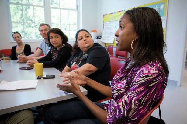 Ayana Douglas and other parents participate in a meeting at Bancroft Elementary School facilitated by Kindred, a nonprofit that goes into D.C. public schools and brings together parents from diverse backgrounds.