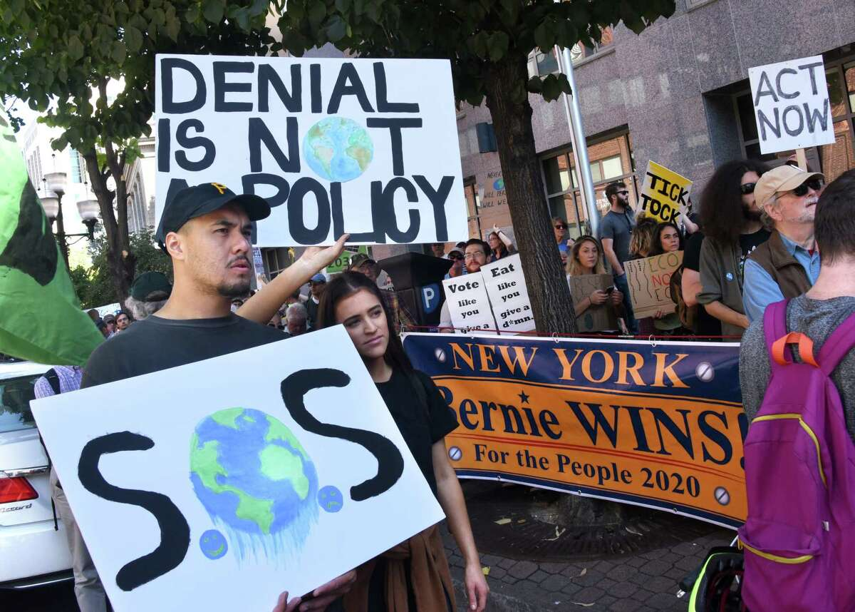 Kyle Holin of Pittsburg, left, stands next to his girlfriend Rachel Eisenberg, an Albany Law School student, as they join Capital District residents in the international student climate strike on Friday, Sept. 20, 2019 in Albany, N.Y. (Lori Van Buren/Times Union)