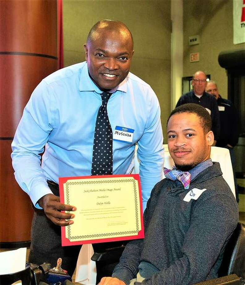 Dalyn Wells, a mass communications major, received the Jack Shaheen Media Image Award at an SIUE Department of Mass Communications award program in March. Presenting him the award is Musonda Kapatamoyo, PhD, chair and associate professor.