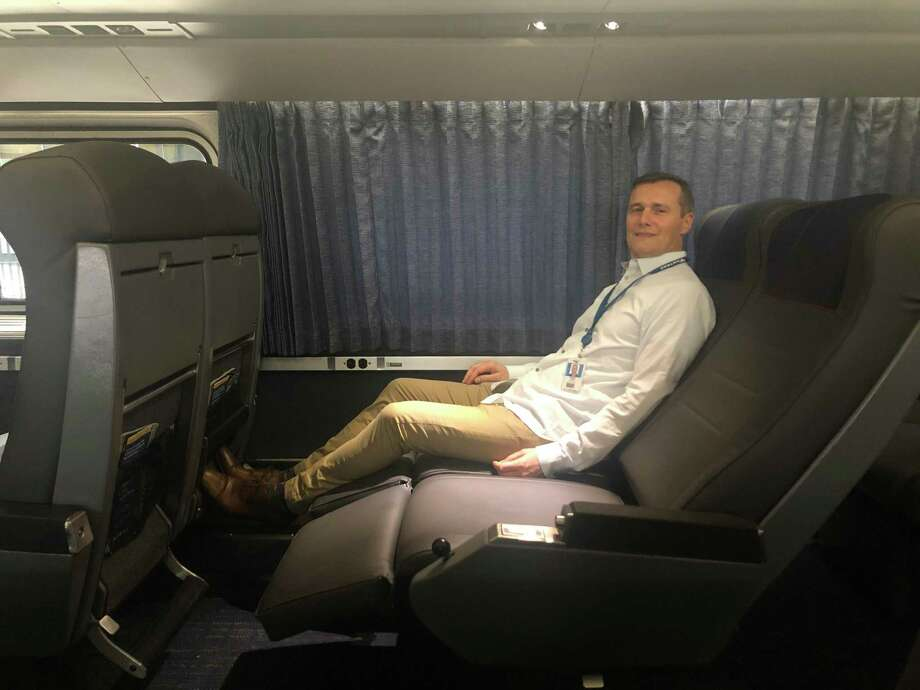 Amtrak chief marketing and revenue officer Roger Harris gets comfortable in a sleeper-car. Photo: Contributed Photo