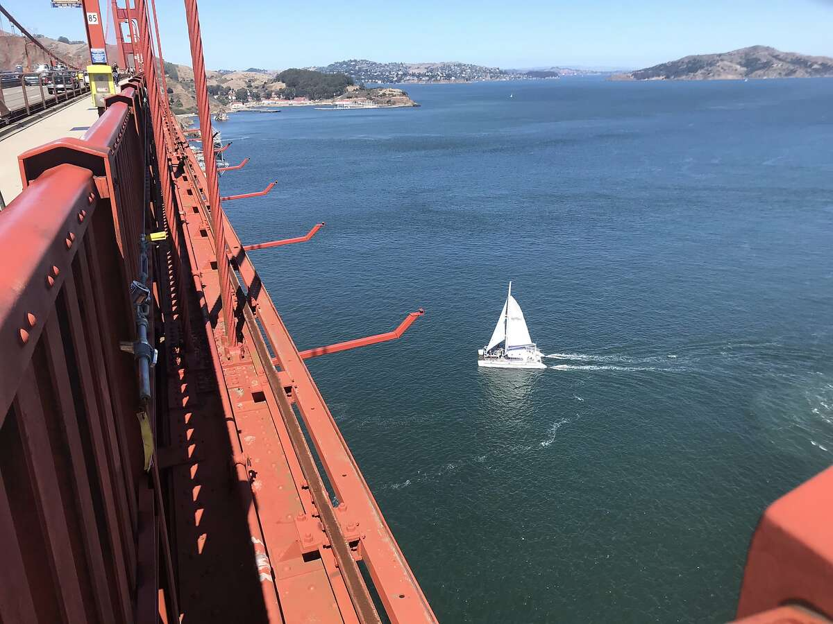 Suicide banner under construction and mid-span of Golden Gate Bridge. August 2019