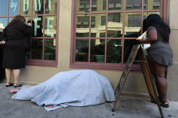 A homeless man sleeps on the sidewalk in Los Angeles. Donald Trump says he plans to seek to have the Environmental Protection Agency declare that California's homeless population constitutes an environmental threat.