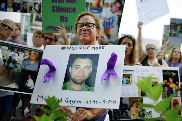 Those who have lost loved ones to opioid overdoses protest at Purdue Pharma in Stamford, Conn., last year. A reader, though, has a different take on responsibility in this crisis.