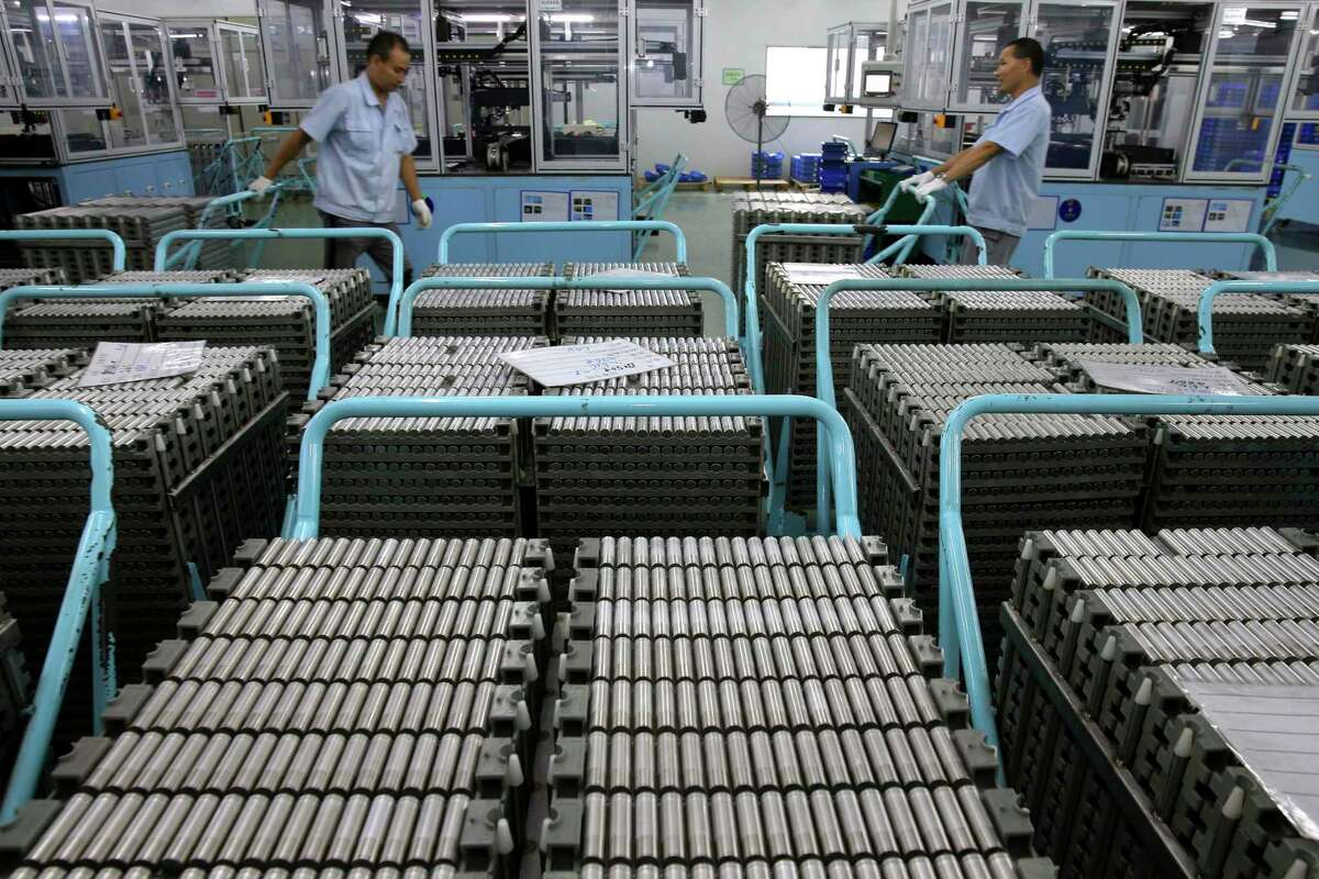 FILE - In this July 27, 2018, file photo, workers transfer Lithium-ion batteries in a factory in Taizhou in east China's Jiangsu province. The U.S. government is leading an ambitious effort to develop ways to recycle lithium-ion batteries from electric vehicles, cellphones and other sources to ensure a reliable and affordable supply of metals crucial to battery production. Officials say it is an attempt to catch up with China and other countries that manufacture and recycle the vast majority of lithium-ion batteries, including those shipped back from the U.S. (Chinatopix via AP, File)