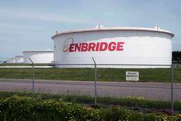 FILE - This June 29, 2018 photo shows tanks at the Enbridge Energy terminal in Superior, Wis. The Wisconsin Supreme Court ruled Thursday, June 27, 2019, that Canada-based Enbridge Energy doesn't need to carry additional insurance for a pipeline project in Dane County, despite the local government's insistence that it do so in case of an accidental spill. (AP Photo/Jim Mone, File)