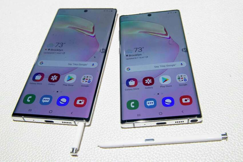 FILE - This Aug. 7, 2019 file photo shows the Samsung Galaxy Note 10, right, and the Galaxy Note 10 Plus on display during a launch event in New York. If youa€™re among the a€œearly adoptersa€ who need to be first on the block for every technological advancement, youa€™ll need a 5G phone with Android. Samsung, Motorola, LG and OnePlus are among the companies that already have 5G models using Googlea€™s operating system. Apple isna€™t expected to release a 5G iPhone until next year. (AP Photo/Mary Altaffer, File)