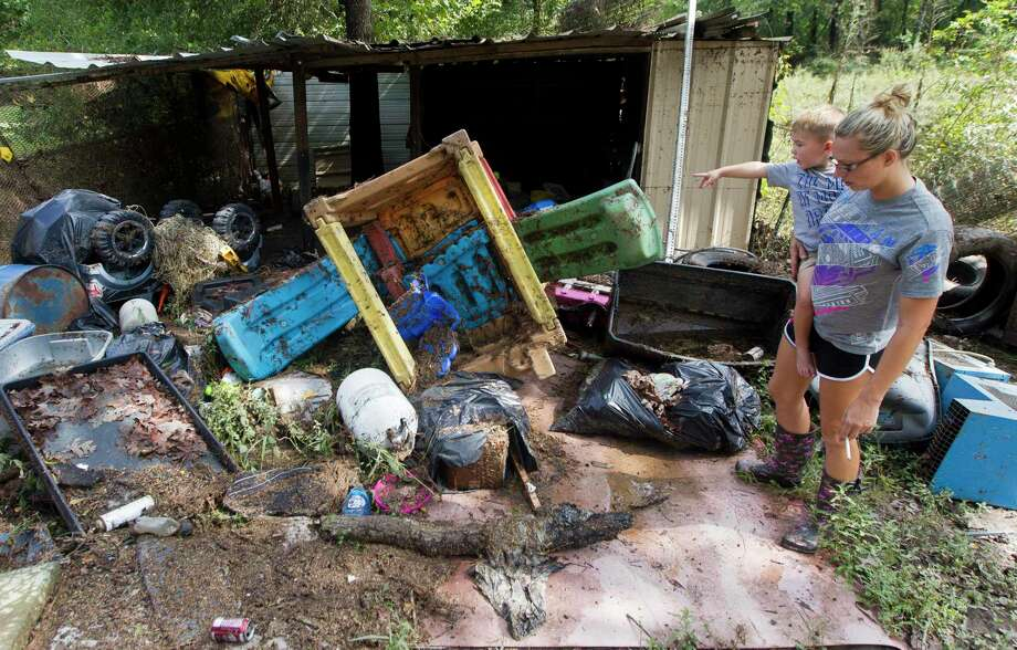 "Braxton Lowen, 3, points to several of his toys he and his mother, Tiffany, discovered had floated from their home to a shed at the back of their property after it was flooded with three and a half feet of water from Tropical Depression Imelda, Friday, Sept. 20, 2019, in Splendora. ""Water took my toys, Mommy,"" Braxton observed. Photo: Jason Fochtman, Houston Chronicle / Staff Photographer / Houston Chronicle"