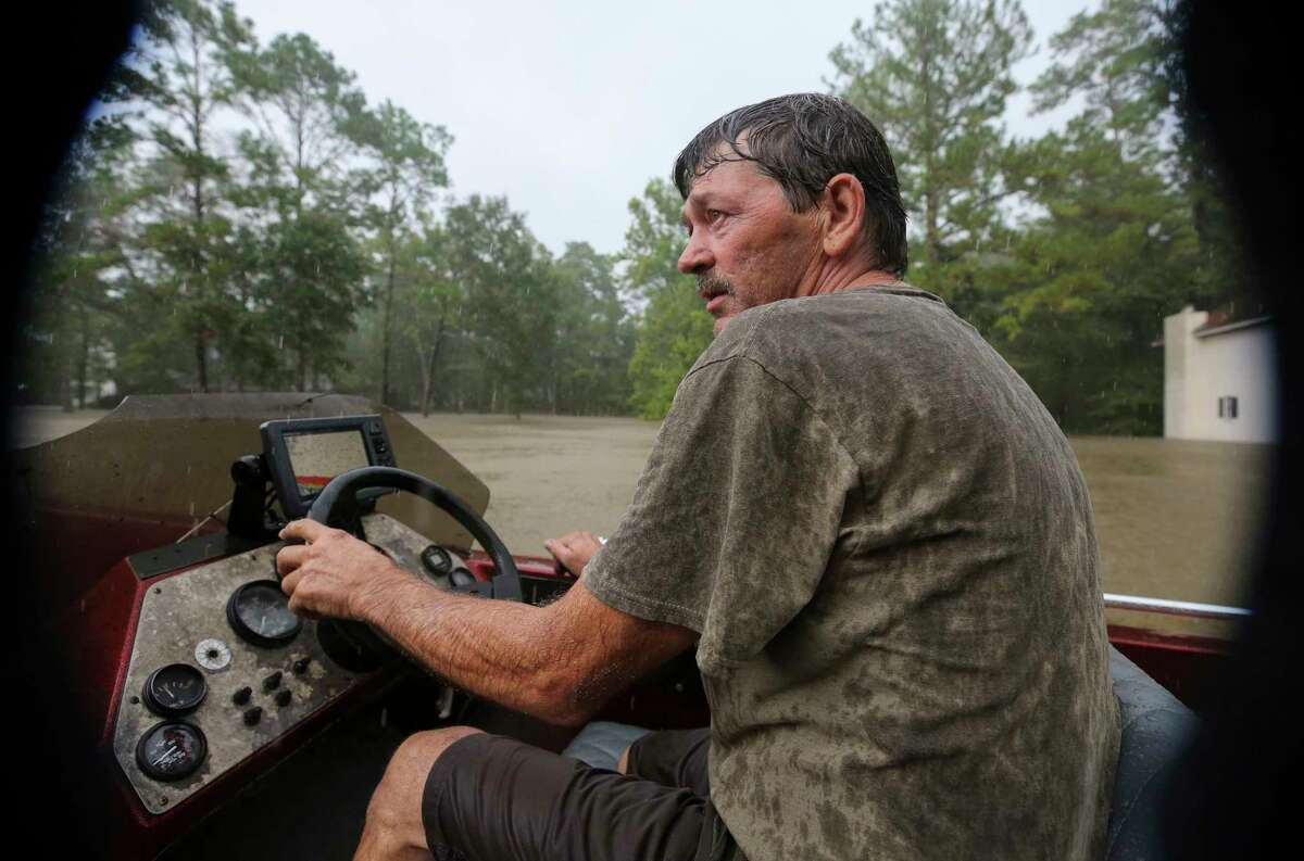 Mark Perkins drives his boat in the Lochshire neighborhood, looking for anyone wanting to evacuate their flooded homes Friday, Sept. 20, 2019, in Huffman, Texas. The Luce Bayou overflowed due to the heavy rain during Tropical Storm Imelda.