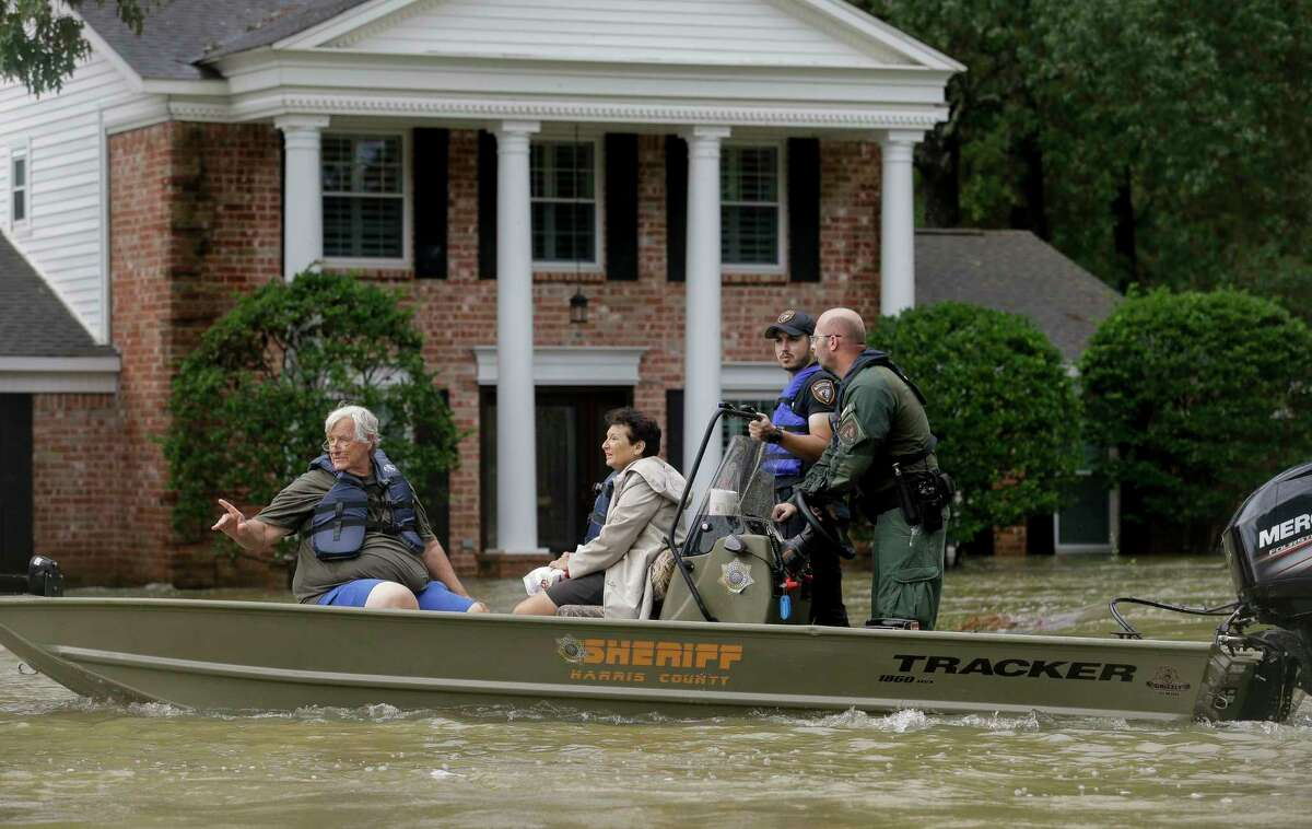 Harris County Sheriff's Office deputies evacuate Carrie and Larry LeBlanc from their flooded home Friday, Sept. 20, 2019, in Huffman, Texas. The Luce Bayou overflowed due to the heavy rain during Tropical Storm Imelda.