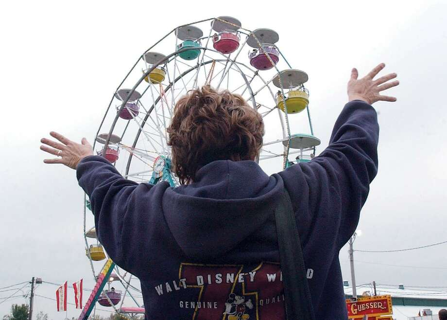 Jane Solomine of East Haven waves to her husband and children riding on the Ferris wheel at the Durham Fair in this September 2003 archive shot. Photo: Hearst Connecticut Media File Photo
