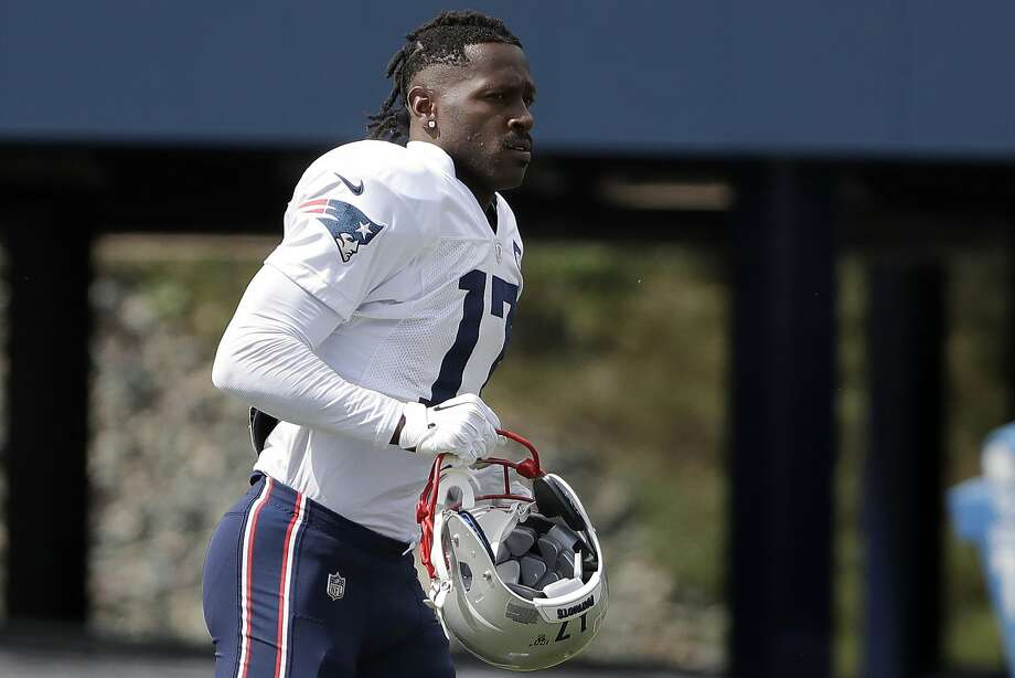 FILE - In this Wednesday, Sept. 18, 2019, file photo, New England Patriots wide receiver Antonio Brown carries his helmet during an NFL football practice in Foxborough, Mass. The Patriots released Brown on Friday, Sept. 20, 2019. (AP Photo/Steven Senne, File) Photo: Steven Senne, Associated Press