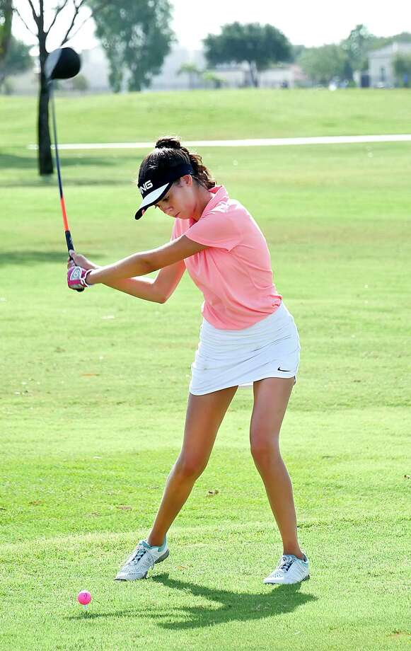 After the first round of the 19th Border Olympics high school girls' golf tournament, Alexander's Catherine Flores has the individual lead by 11 strokes to help the Lady Bulldogs lead by 50 strokes. Photo: Cuate Santos /Laredo Morning Times File / Laredo Morning Times