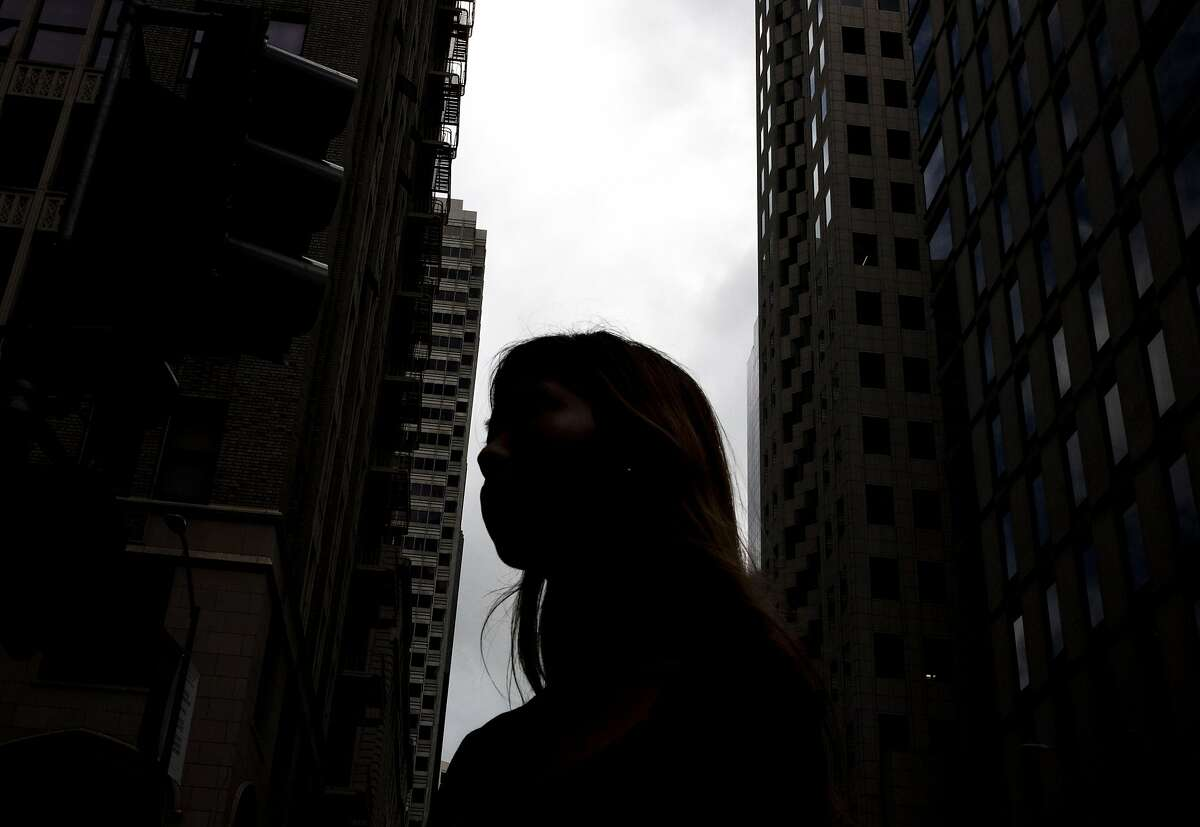 A woman who wished to remain anonymous poses for a portrait in the Financial District of San Francisco, Calif. Wednesday, September 18, 2019.