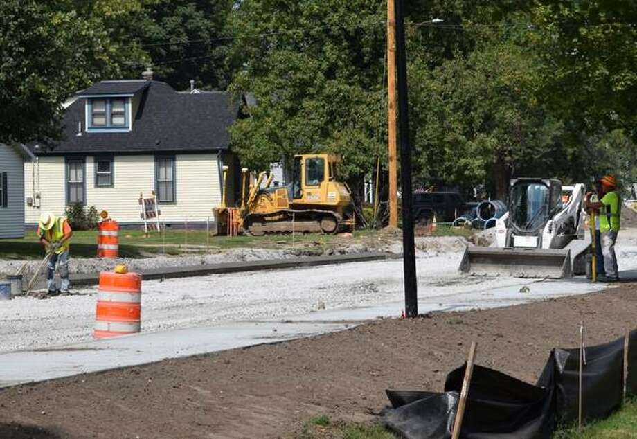Workers from Keller Construction work on the west side sidewalks on Hale Avenue from Troy Road to Lake Drive. Photo: Tyler Pletsch | The Intelligencer