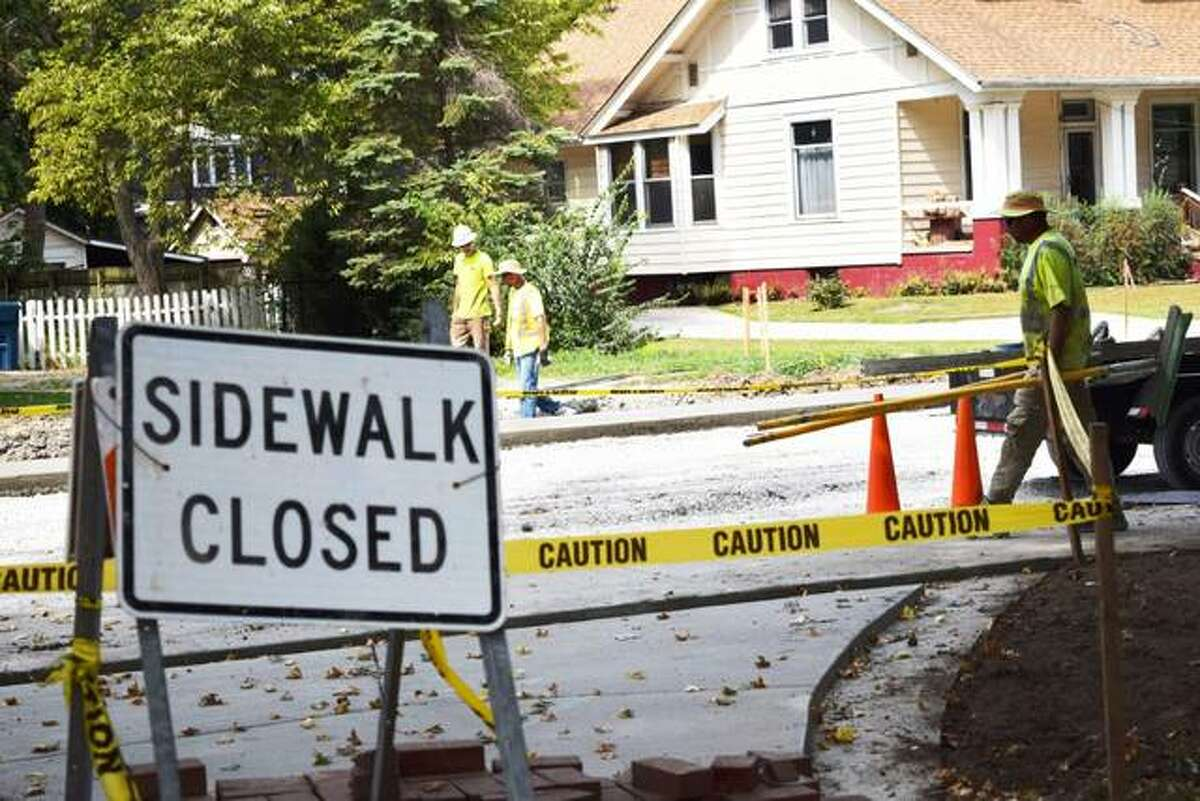 Workers from Keller Construction work on the west side sidewalks on Hale Avenue from Troy Road to Lake Drive.