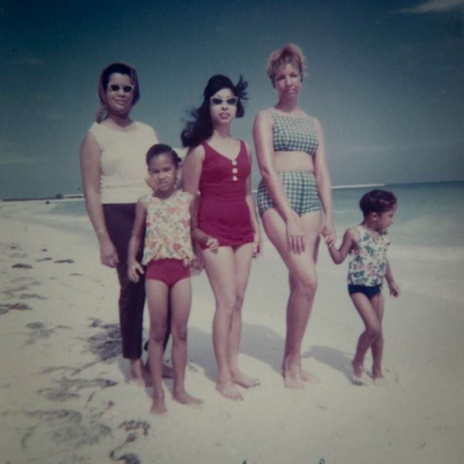 Donna Moodie visits the beach with her family and her mother, Marjorie. Photo: Courtesy Marjorie